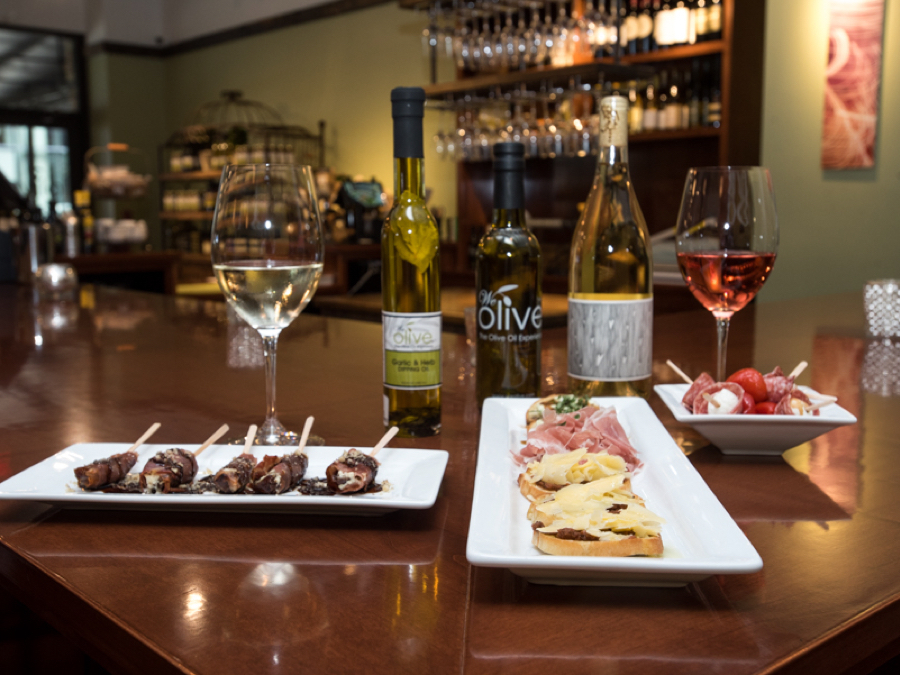 We Olive & Wine Bar - artisan wines paired with delicious small plates. The perfect date night!